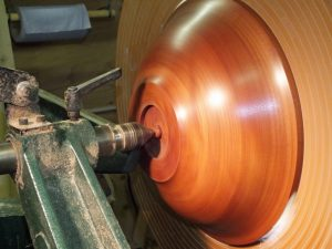 Bowl fixed on lathe to finish base