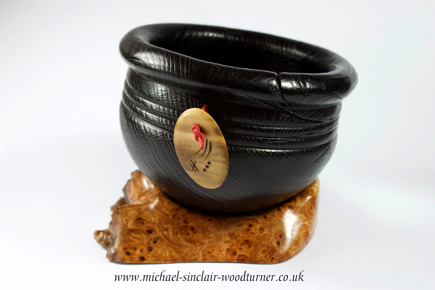 Ebonised bowl with boxwood amulet